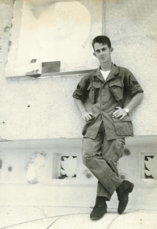 Sgt Dwight Goggans visits a shrine - South Vietnam